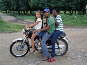 Dominican Family on a motorcycle